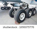 close up of aircraft wheel at... | Shutterstock . vector #1050375770