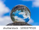 large crystal ball and blue sky. | Shutterstock . vector #1050379520