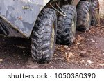 big rubber wheels row on old... | Shutterstock . vector #1050380390
