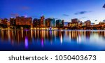 downtown orlando comes alive in ... | Shutterstock . vector #1050403673