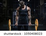 handsome young fit muscular... | Shutterstock . vector #1050408023
