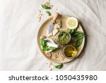traditional basil pesto sauce... | Shutterstock . vector #1050435980