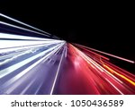 traffic car light trails... | Shutterstock . vector #1050436589