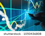 a business person tracking the... | Shutterstock . vector #1050436808