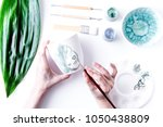 painted ceramic cup on white... | Shutterstock . vector #1050438809