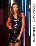 brunette woman wearing elegant...   Shutterstock . vector #1050440024
