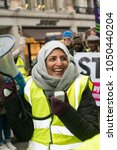 Small photo of London, UK. 17th March 2018. EDITORIAL - Muslim woman activist using megaphone at the March Against Racism national demonstration, London, in protest of the dramatic rise in race related attacks.