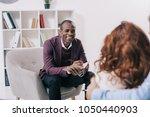 smiling african american... | Shutterstock . vector #1050440903