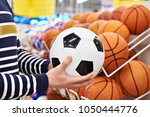 buyer's hands with football and ... | Shutterstock . vector #1050444776