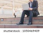 business man is using a laptop...   Shutterstock . vector #1050469409