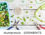 work table with beads and... | Shutterstock . vector #1050480473