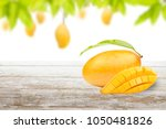 mango on wood with fruit on...   Shutterstock . vector #1050481826