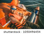 dog and owner on yacht bord on... | Shutterstock . vector #1050496454