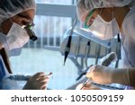 doctor and assistant during... | Shutterstock . vector #1050509159