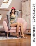 beautiful young girl wearing... | Shutterstock . vector #1050516239