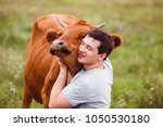 the care of man about cows.... | Shutterstock . vector #1050530180