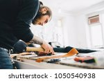 leather craftsman working with... | Shutterstock . vector #1050540938