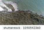 aerial top down photo edge of... | Shutterstock . vector #1050542360