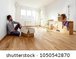happy young man just moved into ... | Shutterstock . vector #1050542870