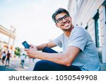 happy young man in eye glasses... | Shutterstock . vector #1050549908