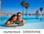 tourist couple having bath in... | Shutterstock . vector #1050551936