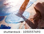 close up of artist's brush and... | Shutterstock . vector #1050557693