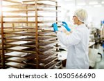 young female dedicated bakery... | Shutterstock . vector #1050566690