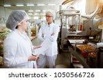 focused dedicated tired female... | Shutterstock . vector #1050566726