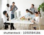 friendly multi ethnic team... | Shutterstock . vector #1050584186