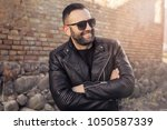 portrait of men with sunglasses ... | Shutterstock . vector #1050587339