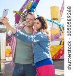 beautiful tourist couple... | Shutterstock . vector #1050589268