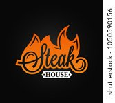 steak logo flame vintage... | Shutterstock .eps vector #1050590156