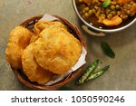 Small photo of Indian Masala Poori / Puri served with Aloo Mutter , selective focus