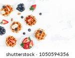 belgian waffles with fresh... | Shutterstock . vector #1050594356