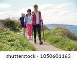 senior people nordic walking by ... | Shutterstock . vector #1050601163