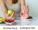 dieting or good health concept. ... | Shutterstock . vector #1050601700
