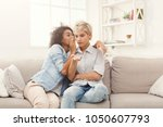 diverse female friends sharing... | Shutterstock . vector #1050607793