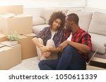 happy african american couple... | Shutterstock . vector #1050611339