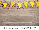 yellow paper flags garland on... | Shutterstock . vector #1050611459