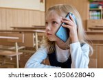 a first grade student at school ... | Shutterstock . vector #1050628040