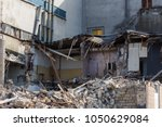 an abandoned house collapses in ... | Shutterstock . vector #1050629084
