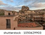Small photo of Italy, Southern Italy, Region of Basilicata, Province of Matera, Matera. The town lies in a small canyon carved out by the Gravina. Overview of town and the cave church Madonna de Idris in background.