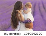 happy mother with pretty... | Shutterstock . vector #1050642320