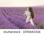happy mother with pretty... | Shutterstock . vector #1050642326