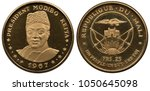 Small photo of Mali Malian golden coin 25 twenty five francs 1967, President Modibo Keita, bust facing, arms, fortress flanked by two bows with arrows, radian sun below, flying eagle above