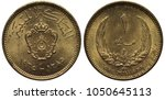 Small photo of Libya Libyan coin 1 one millieme 1965, ruler Idris I, arms, crowned shield with designs above dates, denomination above floral composition