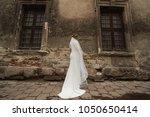 the bride is standing next to... | Shutterstock . vector #1050650414