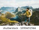 bearded man traveler standing... | Shutterstock . vector #1050651566