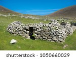Ruins of an old c.1830 blackhouse on the island of Hirta, St Kilda, Outer Hebrides, Scotland. These houses had no windows and no chimney so the smoke from the central fire blackened the interior.