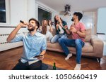 group of friends playing... | Shutterstock . vector #1050660419